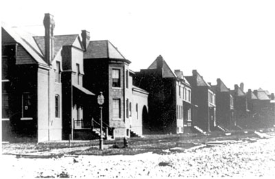 Houses on Cottage Grove under construction, 1881