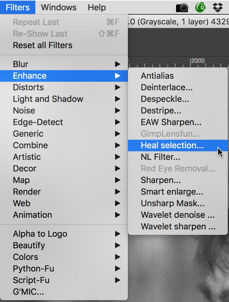 A menu screen-shot of selecting the GIMP heal selection tool