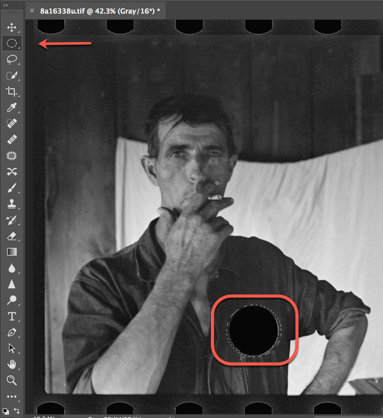 Figure 4 photograph with a selection tool highlighting the hole in the man's shirt